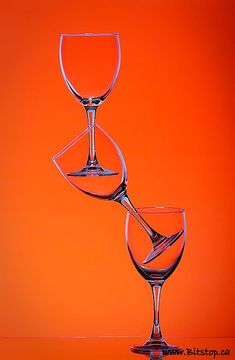 orange background through crystal glasses
