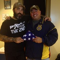 """Aaron with Port Authority Officer Will Jimeno, whose story was portrayed in the Oliver Stone film """"World Trade Center"""". Will was buried in the rubble of the fallen towers for 13 hours alongside Port Authority Officer John McLoughlin, until both were rescued.    Backstage at last night's show in Reading, Aaron was presented with a flag that flew over at the site of the World Trade Center during the rescue efforts, as well as a piece of steel that was cut from the rubble during the rescue."""