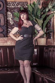 Teer Wayde in a belted polka-dot pinup dress