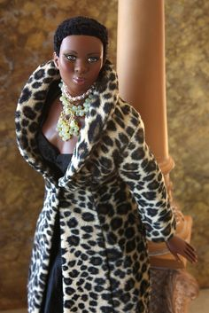 """Animal Kingdom Doug James and Laura Meisner's Colin wears a fantastic tribute to Anne Bancroft in """"The Graduate"""" in this luxurious coat by Joshard. Necklaces by Joy Jarred. Beautiful Barbie Dolls, Vintage Barbie Dolls, African American Dolls, American Women, American History, Diva Dolls, Dolls Dolls, Ebony Models, Black Barbie"""