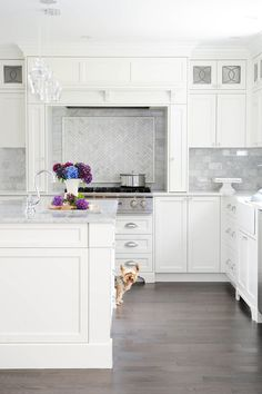 Lately I have been a little obsessed with slab marble back splashes, I love this look but I also love the mosaic marble that I have been seeing.  It goes well w