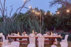 DIY decoration. http://flyawaybride.com/rustic-destination-wedding-spain/ Photography: Nadine van Biljon | Venue: Rancho del Ingles | Florist: Viveros Guzman | #WeddinginSpain #Venue #Destinationwedding #candles #tablescape