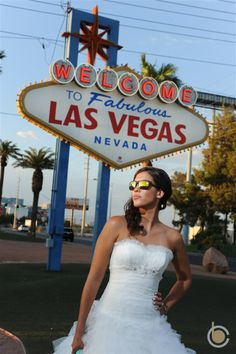 How cool is this bride at the Las Vegas sign? Las Vegas Sign, Las Vegas Nevada, Shades, Couture, Bride, Wedding Dresses, Hot, Wedding Bride, Bride Dresses
