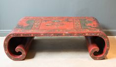 19th Century Chinese Red Lacquer Scroll Low Cocktail Table | From a unique collection of antique and modern coffee and cocktail tables at https://www.1stdibs.com/furniture/tables/coffee-tables-cocktail-tables/