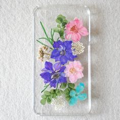 Lewire Violets Handmade Real Pressed Flowers Phone Case For iPhone 5/5S 072807. Handmade item. Made from Dried Pressed Flowers, clear durable plastic and resin. This is Real Dried Flower and leaf. Real Dried Flower and Leaf are covered by clear resin. Due to nature of flower, each pressed flower may look slightly different from pictures.