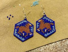 These beautiful Running Horses Earrings are made with delica glass beads. They are done in a Peyote Stitch. They are 2.5 inches long from the top of the silver french hook and 1 inch wide. They are light weight, fun and would be a great addition to any outfit. Thank you for your order!    Have a great day