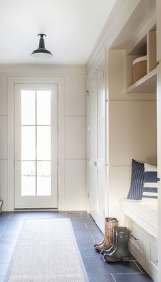 The paint color for this mudroom is Benjamin Moore Revere Pewter HC 172.
