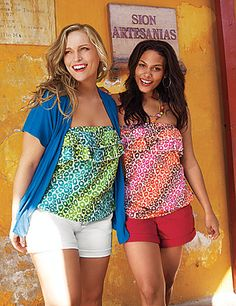 Dare to bare with this so-stylish animal print tube top from our Fun & Flirty collection. Detailed with layered ruffles and a flattering banded bottom silhouette, this sassy warm-weather favorite offers two sexy looks in one with optional straps. Crops, skirts and more have met their match.  lanebryant.com