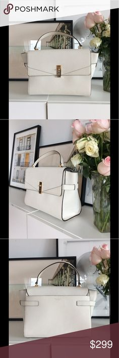 Henri Bendel White tote White gorgeous tote with gold hardware. Worn twice. All leather with plenty of storage. henri bendel Bags Totes