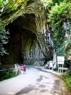 A cave opening in Spain (council of Ribadesella. community of Asturias, town of Cuevas del Agua) Tourist Places, Vacation Places, Places To Travel, Places To See, Beautiful Places In The World, Wonderful Places, Travel Around The World, Around The Worlds, Asturias Spain