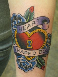 """I want a chest piece someday with the center a heart shaped box with a key whole with roses, lillies, sunflowers, and the lyrics """"I've been locked inside your heart shaped box for weeks. Rose Heart Tattoo, Simple Heart Tattoos, Tattoos With Kids Names, Tattoos For Women, Nirvana Tattoo, Nirvana Art, Couple Tattoos, New Tattoos, Shape Tattoo"""