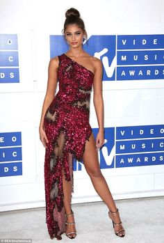 Taylor Hill shows long stems in red gown with thigh high slit at VMAs