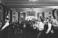 Garter toss during a wedding reception at the Belvedere Hotel. Captured by NYC wedding photographer Ben Lau.