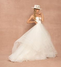 Style 62005 Loretta Hayley Paige bridal gown - Ivory draped satin and tulle ball gown, structured strapless sweetheart bodice with cuffed neckline, cascading tulle skirt with double horsehair trim.