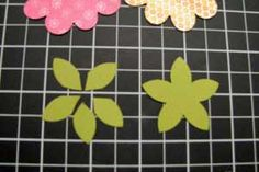 """Flower Pot Card - Step 10 - Punch each 2 ½"""" x 2 ½"""" piece of green cardstock with the 5-Petal Flower Punch and cut apart to create leaves. . . . .     Read more: http://www.splitcoaststampers.com/resources/tutorials/flowerpotpocket/"""