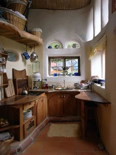 Shaped cabinetry, shelves and benchtops suit the straw bale window design here - but its all a little organic for my taste. But definitely deserves a pin!