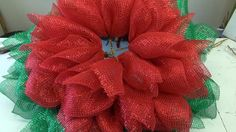 This is pretty much a repeat of our Poinsettia Wreath Tutorial, but it's made with different fabric.