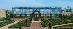 This structure also includes two partitions dividing the greenhouse into three different temperature zones.