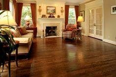 """Picture of 2 1/4"""" narrow strip red oak flooring that was sanded and stained with Dura Seal coffee brown stain. The floor was coated with two coats of GlitsaMax 2 component waterborne finish."""
