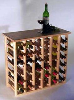 """From WineRacks.com: 36 Bottle Wine Rack for $305.95. Built in the US.    These handsome racks are constructed out of solid oak and are perfect as a small side table or even serving bar. Each rack has a clear satin finish that will protect your rack for years to come.    Dimensions: 23 5/8"""" T x 29 """" W x 11 1/2"""" D"""