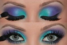 Blue and purple two toned shadows with winged liner.