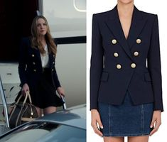 "Fallon Carrington (Elizabeth Gillies) wears this dark navy blue double breasted gold button blazer in this episode of Dynasty, ""I Hardly Recognized You"". It is the Balmain Wool Double-Breasted Blazer."