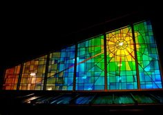 Stained Glass. Love the squares background and the circles radiating from the center.