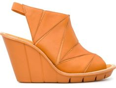 For Spring Summer 2013 Camper presents Filippa High, an open sandal made of medium brown full grain leather uppers and a lightweight EVA wedge in orange measuring 9,5 centimetres. . Packed with Camper character it offers a feminine, soft, summer look.