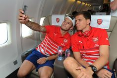 See Arsenal players go into selfie overload as they board the plane for New York