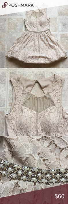 Beautiful Occasion dress Blush nude colored dress. Laced patterned with tooled material underneath the dress.  Size 7 and only worn once. Pearl belt decoration No tears  Price firm City Triangles Dresses Prom