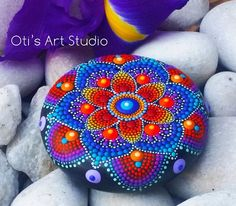 Mandala Stone- Hand Painted  This precious stone was created with much love and joy. The mandala stones have in them many hours of joyful work and prayer for the owner to feel the vibration of joy, happiness and worth of our beautiful Universe.  Size: 6cm.in diameter/ 2 1/2inch.  I use a natural stone as this is the best canvas to paint and express my love for color and my gratitude to Mother Earth. Jewel stone hand painted mandalas must be handled with care and they are not suitabl...