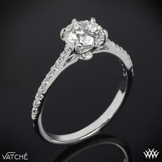 """Classically styled, the """"Felicity Pave"""" Diamond Engagement Ring by Vatche shines bright with 20 Round Brilliant Diamond Melee (0.13ctw G/VS) along the shank. The lovely 6 prong head ensures that your diamond is always secure. This is the sister ring to our """"Felicity"""" Solitaire Engagement Ring and is part of our Serenity Collection. The width tapers from 1.3mm ..."""
