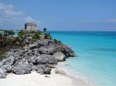 Tulum's ruins overlook the beautiful blue waters of the Caribbean.