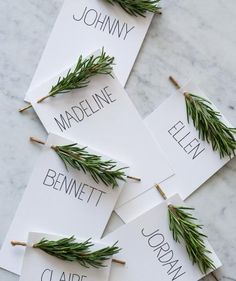 These pretty yet simple place cards incorporate an herb you'll probably be cooking with, too: rosemary. Simply print (or hand write) each person's name on card stock, punch two holes (one in each corner) at the top, and then thread a sprig of rosemary through the holes. Bonus points if you pocket-fold the napkins and slip a place card into each one.