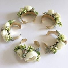Garden roses, stock and dusty miller bridesmaid cuff corsages.