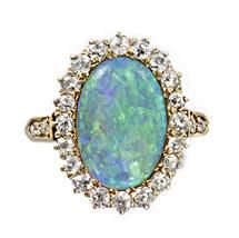 A late Victorian oval opal and diamond cluster ring, ca 1900.