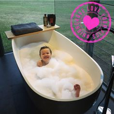 To sum up bath time in one word = joy! We love this picture featuring our Spoon Stone Bath