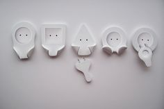 Electrical outlet has a handle to hang on cable. The plugs are to hang until they are in use again. Simple and convenient way so that the plugs don't dangle.   You can save energy <3