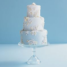 True Blue   A brocade of tiny handmade sugar flowers and crystals adorn this three-tier cake in three shades of robin's egg-blue fondant. Serves 50, from Polly's Cakes.