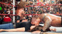 HHH handcuffed to ropes. Randy Orton ddt Stephanie McMahon and kissed her.