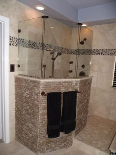 Fascinating Modern Doorless Walk In Shower With Noce Travertine Split Face Accent Walls And Travertine Tile And And River Rock Accents Glass Frameless Shower Along With Multiple Shower Heads Accent Walls In Living Room, Accent Wall Bedroom, Modern Bathroom, Small Bathroom, Bathroom Ideas, Bathroom Remodeling, Bathrooms, River Rock Shower, Multiple Shower Heads