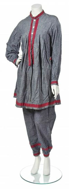 Blue Wool Bathing Ensemble, circa 1860,  comprised of a long sleeve dress with buttons to the bodice, together with a side button waist pant, both with burgundy piping.