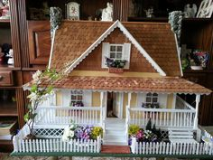 Victorian style cottage. Fully lighted and furnished with handmade and vintage kits. handmade bedspread and carpets. Measurements are; height is