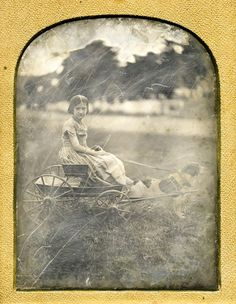 GIRL RIDES IN DOG CARRIAGE c 1850s