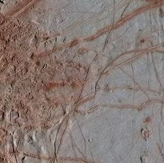 Images of the moon Europa. See the unique terrain on the moon Europa. NASA's Galileo spacecraft captured this image of Europa, Jupiter's icy moon. Sistema Solar, Jumble Puzzle, Jupiter's Moon Europa, All About Space, Jupiter Moons, Moon Surface, Science, Space Probe, Crosses