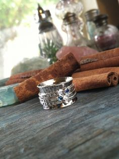 hand stamped Birthstone sterling silver spinner ring mothers ring. $140.00, via Etsy.