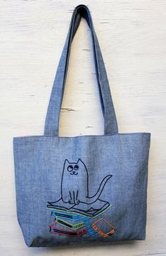 Books and cat/ shoulder bag / minimalist line drawing by NIARMENA, $34.00