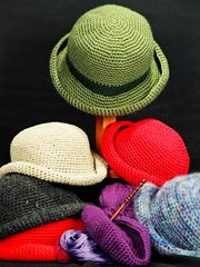 Easy Crocheted Crusher hat pattern - Here's a versatile, packable hat to crochet in a variety of fibers.  This hat is easy and fun to make! Crochet several and wear them year round!  Includes pattern for dolls to adults!