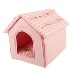 """<p><strong>Lap up the luxury of this unique Snuggle House! </strong></p><br /> <ul><br /> <li>Softest of soft fabric covers the entire house.</li><br /> <li>Solid walls with checkered pattern on the roof.</li><br /> <li><span style=""""text-align: justify;"""">Bone shaped toy included.</span></li><br /> <li>Shell: 100% cotton; Lining: 100% Polyester. Inside cushion is washable.</li><br /> </ul><br /> <p><strong>Why We Love It: </strong></p><br /> <br /> <p>With this unique dog house, your..."""