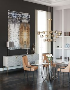Love the sideboard and the artwork! A modern dining room with a contemporary design sideboard in white, Triny. A geometrical pattern makes this sideboard a one of a kind piece. Dining Room Wall Decor, Dining Room Design, Room Decor, Dinning Table, Luxury Dining Chair, Monochromatic Room, Art Deco Home, Interior Decorating, Interior Design
